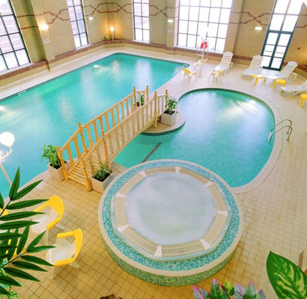 adorable indoor pool with unique shape and decorated with small