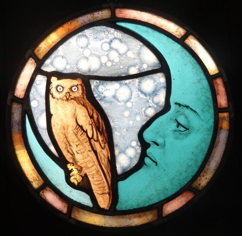 Owl and disgruntled moon stained glass