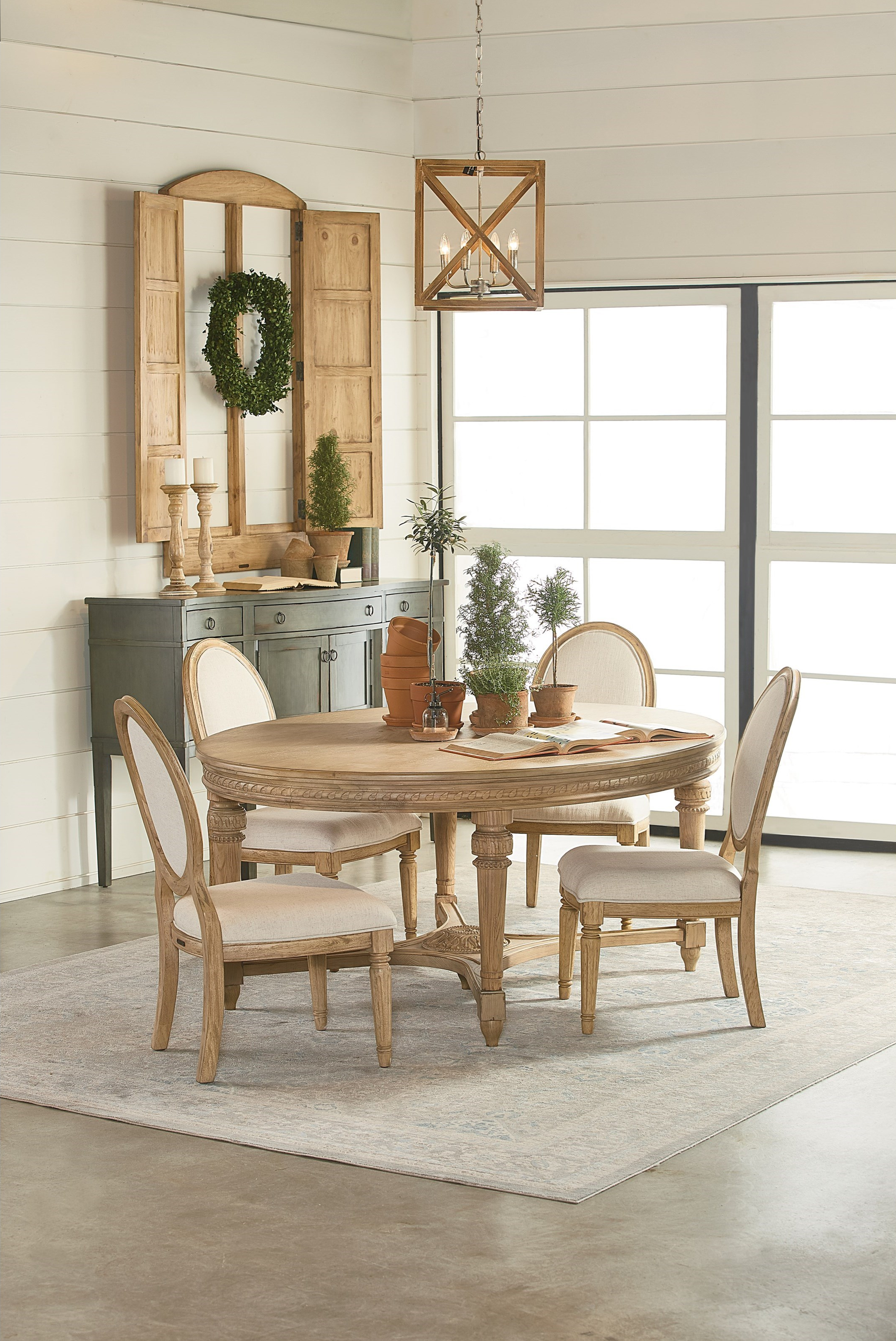 Magnolia home by joanna gaines traditional casual dining room group this traditional dining room set includes a table 4 chairs and sideboard