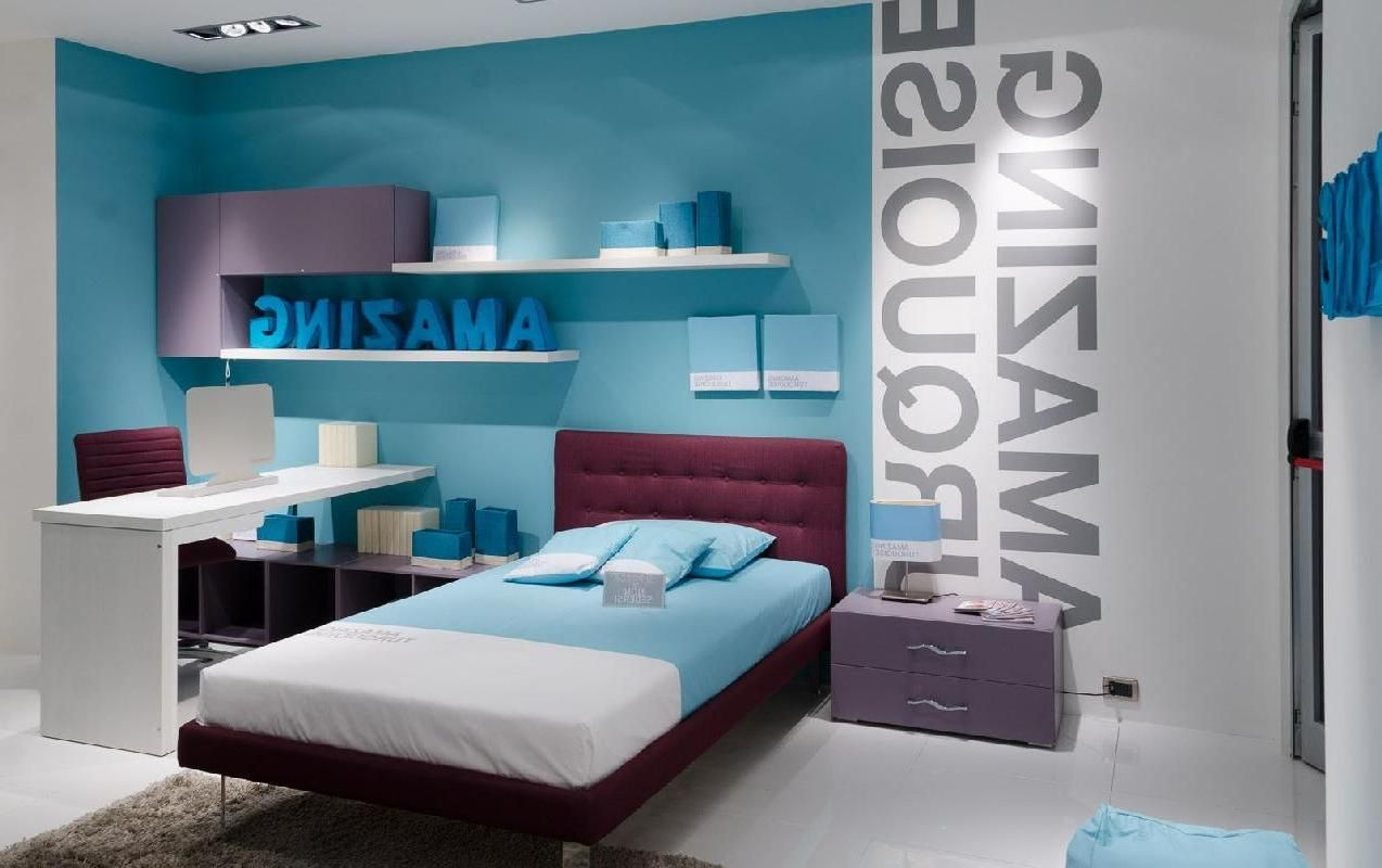 Atrractive Blue Teenage Girl Room Design With Letter Wallpaper And Floating  Cabinet On The Wall Above