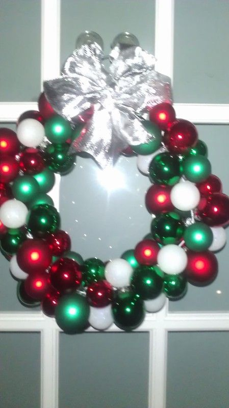 glueless Christmas wreath made with ornaments and a wire hanger ...