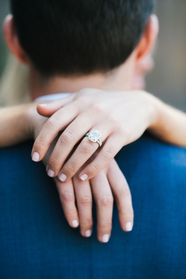 Gorgeous emerald cut halo engagement ring: http://www.stylemepretty.com/new-york-weddings/new-york-city/2016/06/13/this-springtime-engagement-session-is-why-we-love-new-york/   Photography: Still55 Photography - http://still55weddings.com/
