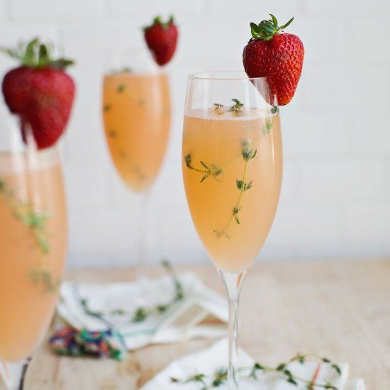 Strawberry infused grapefruit juice adds amazing flavor to this mimosa!