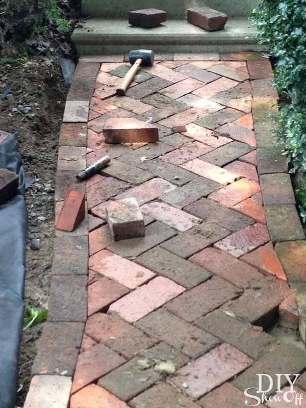 "An old pile of bricks from behind the barn is repurposed for creating a new ""old"" brick patio and walkways underneath our grape arbor/gazebo."