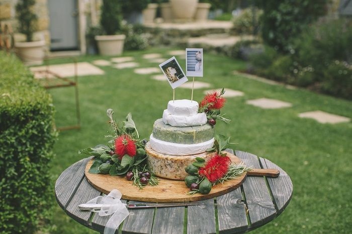 Cheese Wedding Cake topped with Polaroid bride and groom | i take you #cheeseweddingcake