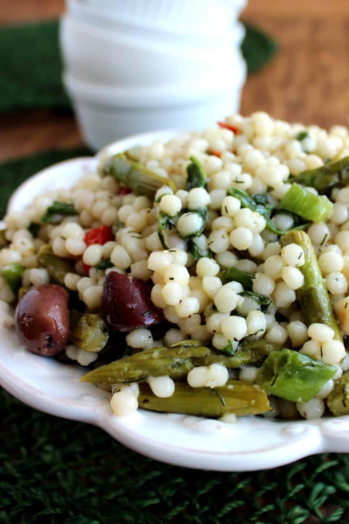 Israeli Pearl Couscous Salad Has An Array Of Veggies Including Asparagus And Olives A Delicious Lunch And Th Couscous Salad Recipes Pearl Couscous Salad Salad