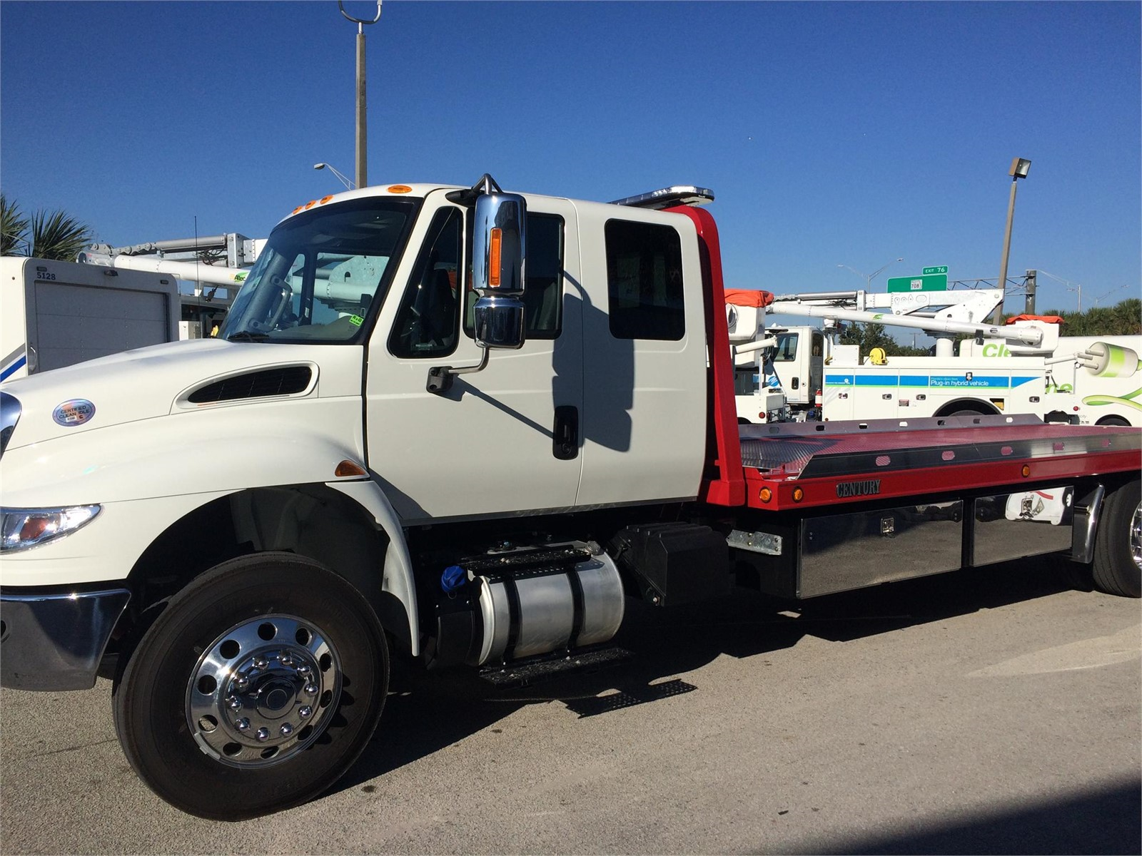 International 4300 extended cab w 24 ft century rollback tow truck
