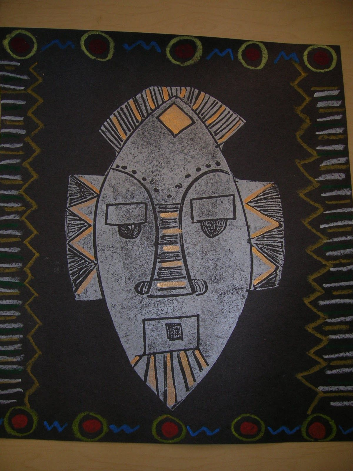 Africa mask prints with added designs with gold paint and