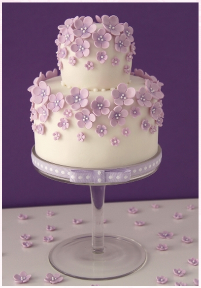 I like this cake but with yellow daisies Moms headpiece had