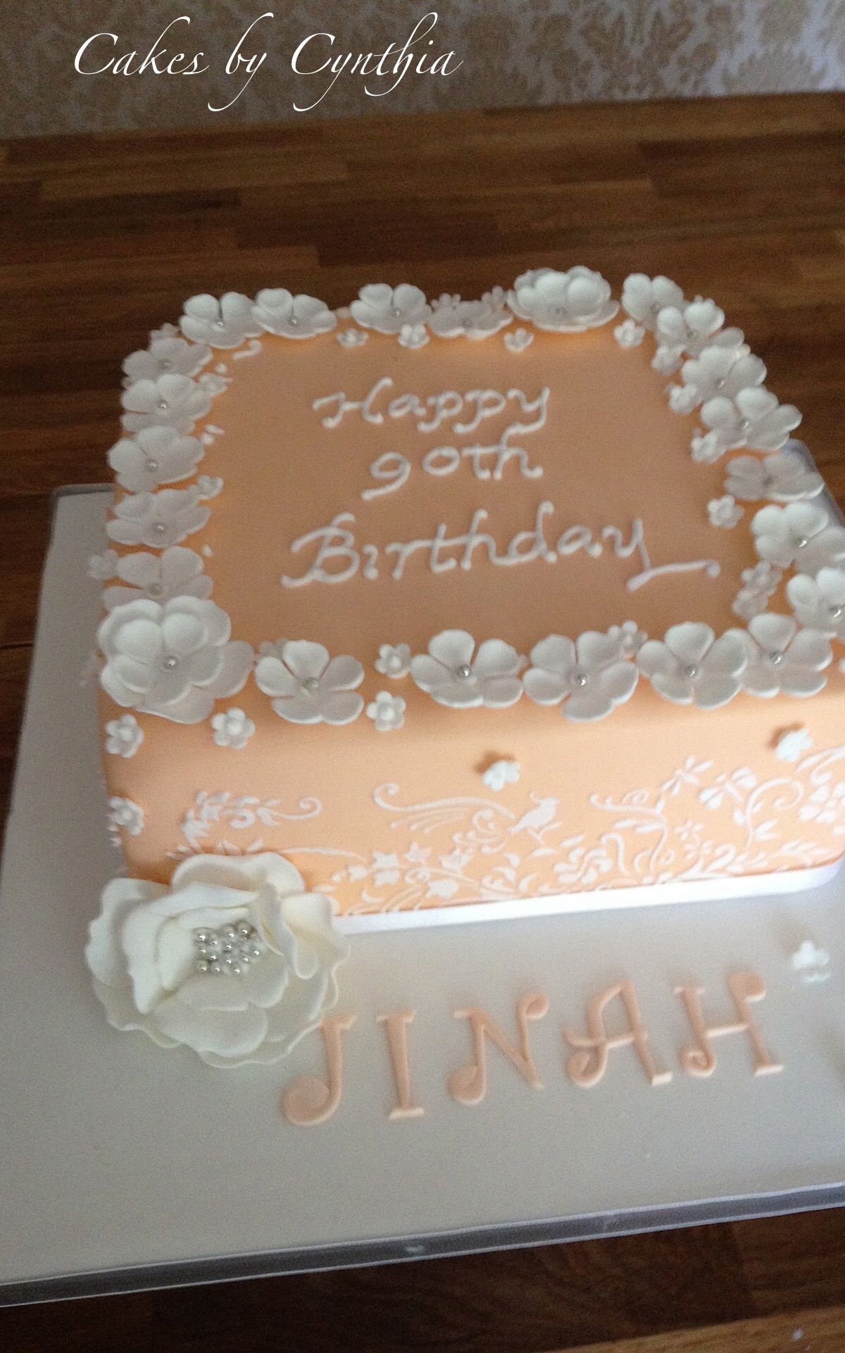 90th birthday cake with stenciling and blossoms Wedding cakes