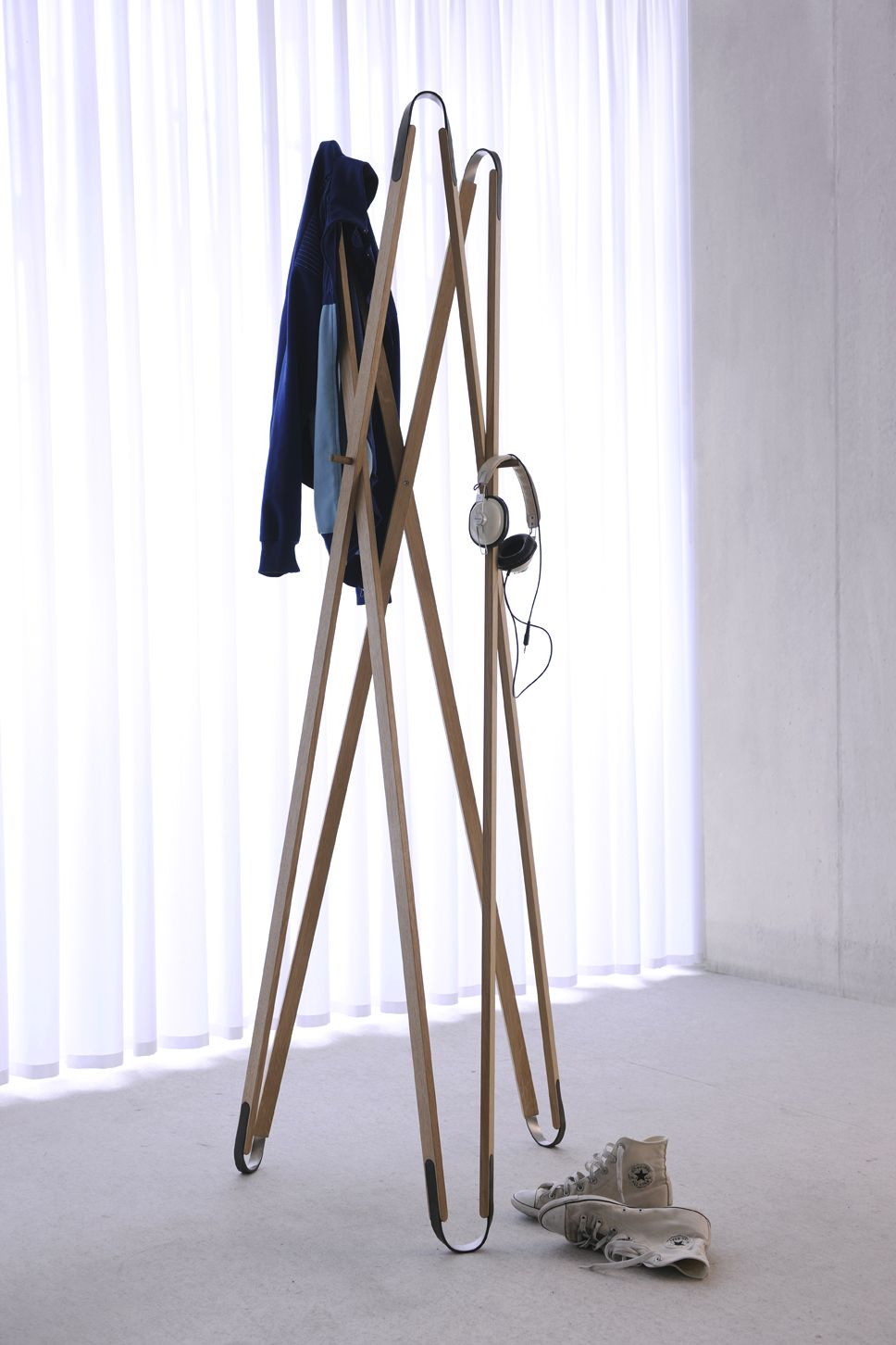 X3 Foldable Coat Stand   Design by Anne Geier & Melinda Barth  Produced by Via Werkstätten Berlin, social responsable Workshop http://shop.via-werkstaetten.de/de/Garderobe-X3  The delicate form consists of simple parts made of traditional materials such as oak, leather and stainless steel. The mechanical coupling devices allows the user to expand and fold up the wardrobe. This is an essential function for easy transportation and storage.