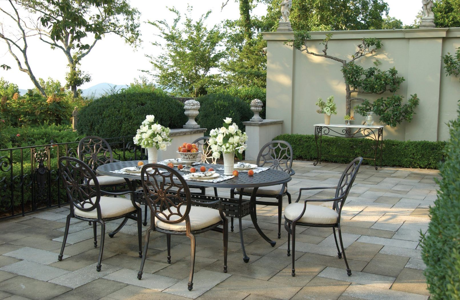 A Short History Of Outdoor Furniture In 2020 Stone Patio Designs Outdoor Garden Table