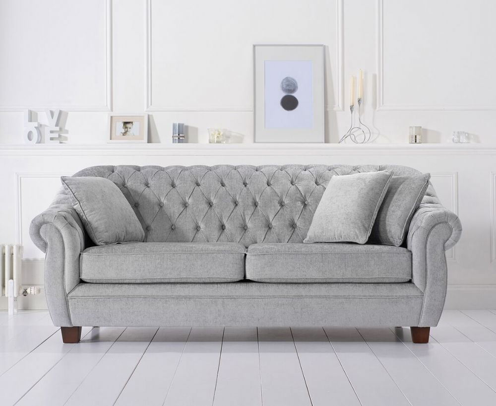 The Liv Chesterfield Grey Plush Three Seater Sofa Ticks All The Boxes When It Comes To Style And Comfort Classi Three Seater Sofa Chesterfield Sofa Fabric Sofa