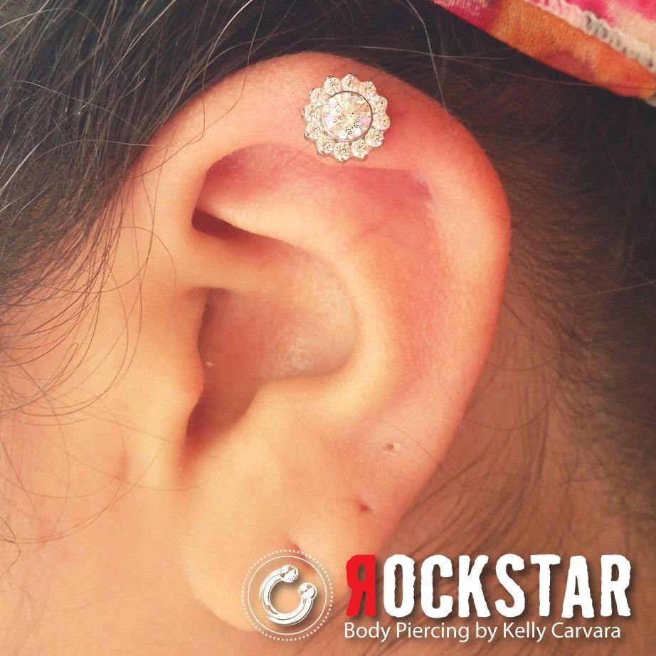New piercing ideas  ODYSSEY Titanium Multi Faceted Gem Threaded flower in a helix