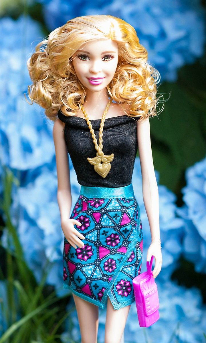 Barbie Fashionistas love any opportunity to get dressed up.  This basic black top pairs perfectly with a bold patterned skirt and colorful clutch.  A perfect ensemble for showcasing flawless style. [ad]