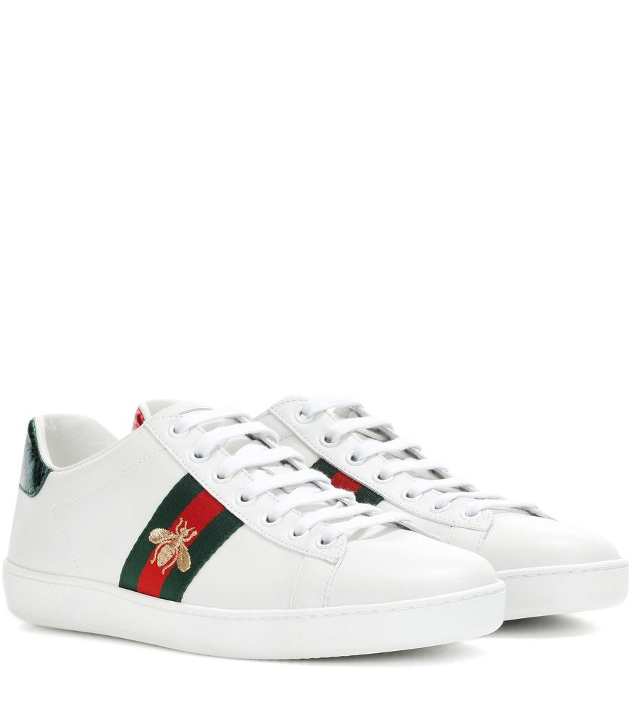 873f80ac34d80 Gucci - Ace leather sneakers - Gucci s Ace sneakers have all the makings of  a cult classic with their intricate detailing and iconic look.