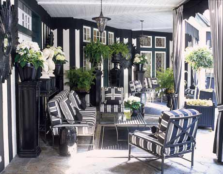 Black and White Design against wrought iron furniture, lighting. Black painted wood crown moulding with green topiaries. There is a lot going on and this scheme can be worked in either a traditional or contemporary direction.