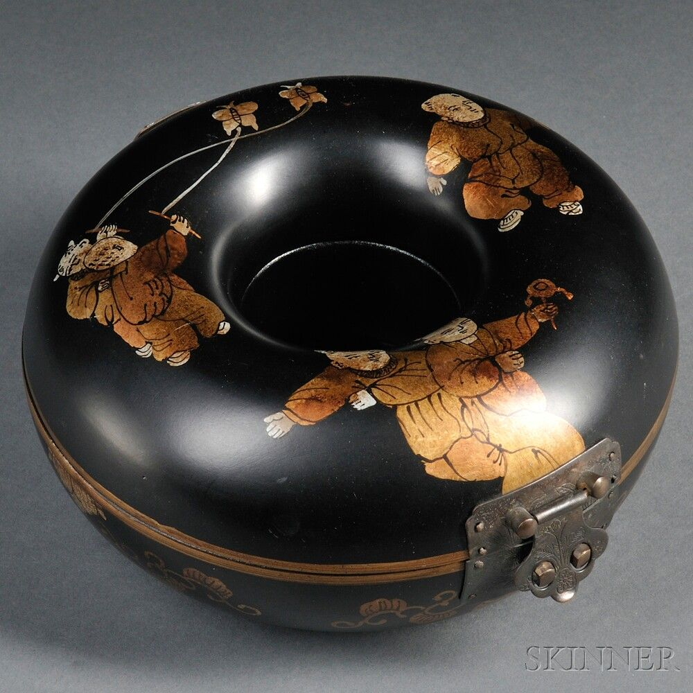 Hinged Wood Box, China, 20th century, donut shape, decorated in gilt with children at play and scrolling foliage