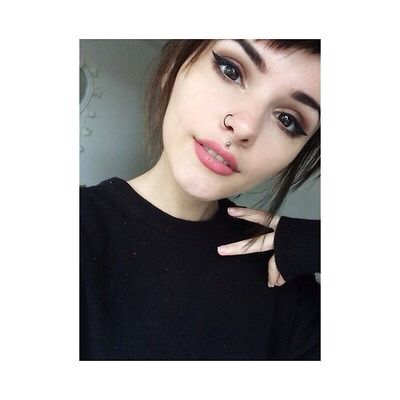 I really miss my nose ring. but I really love her medusa piercing. I might actually do something like that when I can actually pull it off..