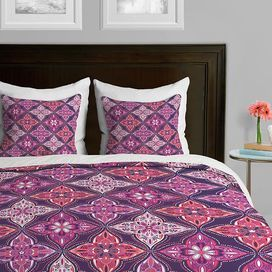 "Create a stylish focal point in your master suite with this eye-catching duvet cover, showcasing a multicolor medallion motif. Made in the USA.   Product: Duvet coverConstruction Material: Polyester microfiberColor: Lavender and multiFeatures:  Designed by Khristian A Howell for DENY Designs Metal snaps closure Fade-resistant White underside   Dimensions: Twin: 88"" x 68""Queen: 88"" x 88""King: 88"" x 104""Note: Shams pictured are not includedCleaning and Care: Machine washable"