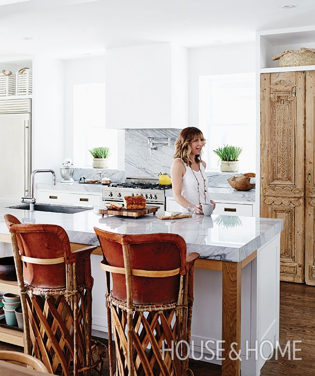 ornate egyptian pantry doors and a pair of vintage leather barstools are what set designer sam sacks kitchen apart photographer michael graydon