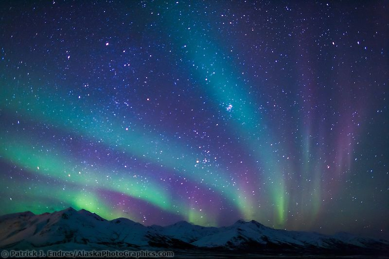 Colorful aurora borealis over the mountains near Chandalar Shelf - new blueprint alberta northern lights