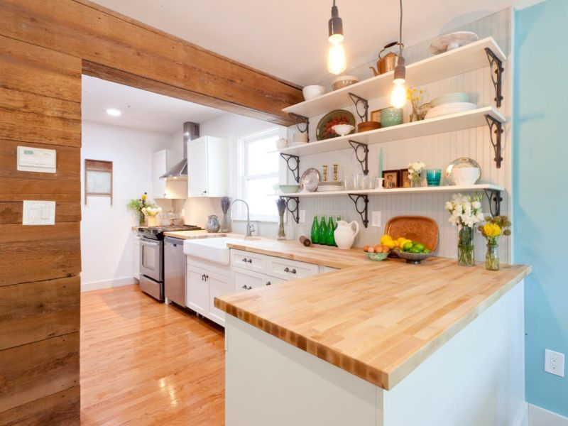 Good The Paneling Along With The Butcher Block Countertops Offers A Rustic Touch  In This Cottage Style Kitchen. Good Looking