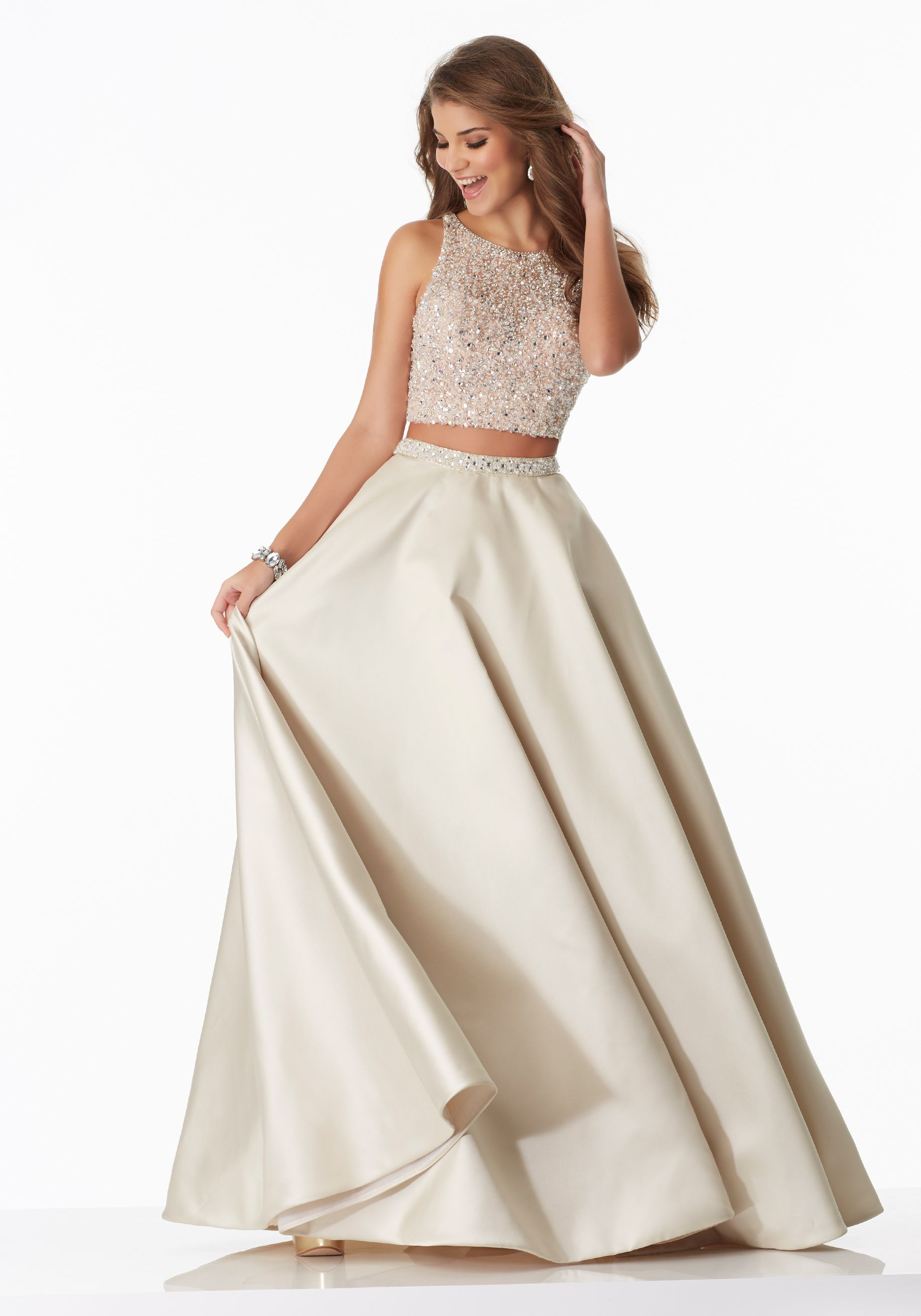 a5d93754621 Prom Dresses by Morilee designed by Madeline Gardner. Elegant and gorgeous  Two-Piece Prom Dress with A-Line Larissa Satin Skirt and Fully Beaded Net  Top.