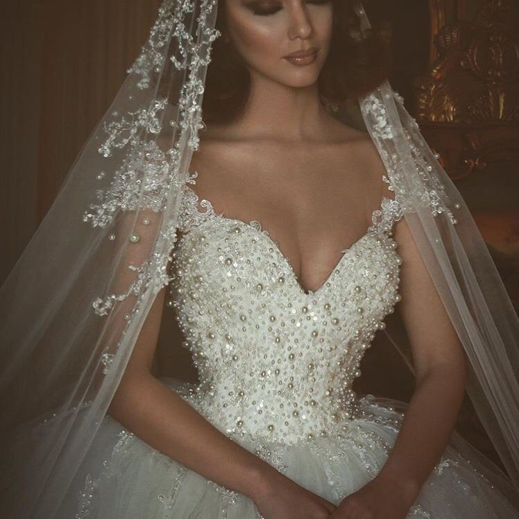 Ball gown wedding dress with veil and tiara