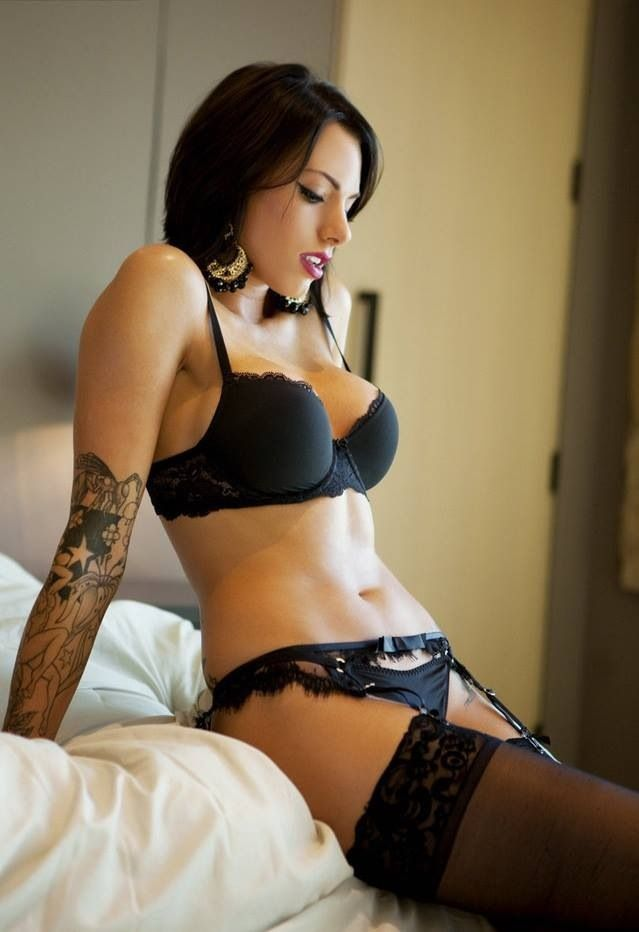 Busty tattooed blonde in sexy black lingerie — img 3