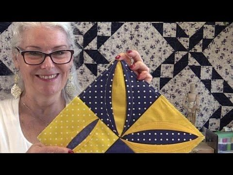 She Folds Back A Piece Of Fabric To Show You How To Make A Special ... : quilting tutorials on youtube - Adamdwight.com