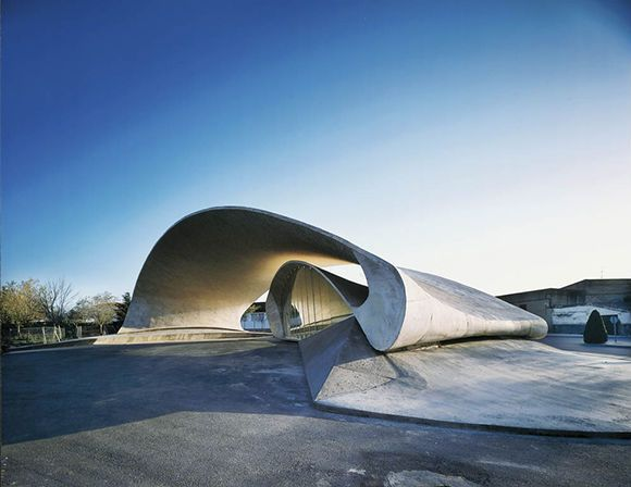 A concrete shell working in compression is transformed