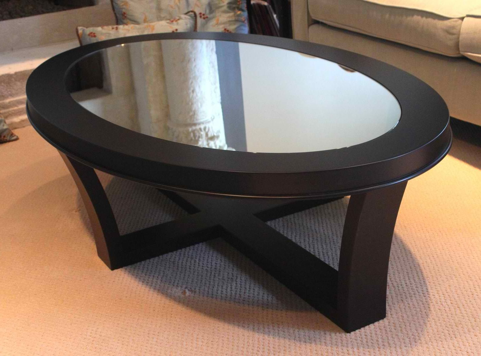 Adjustable height round glass top coffee table with 4