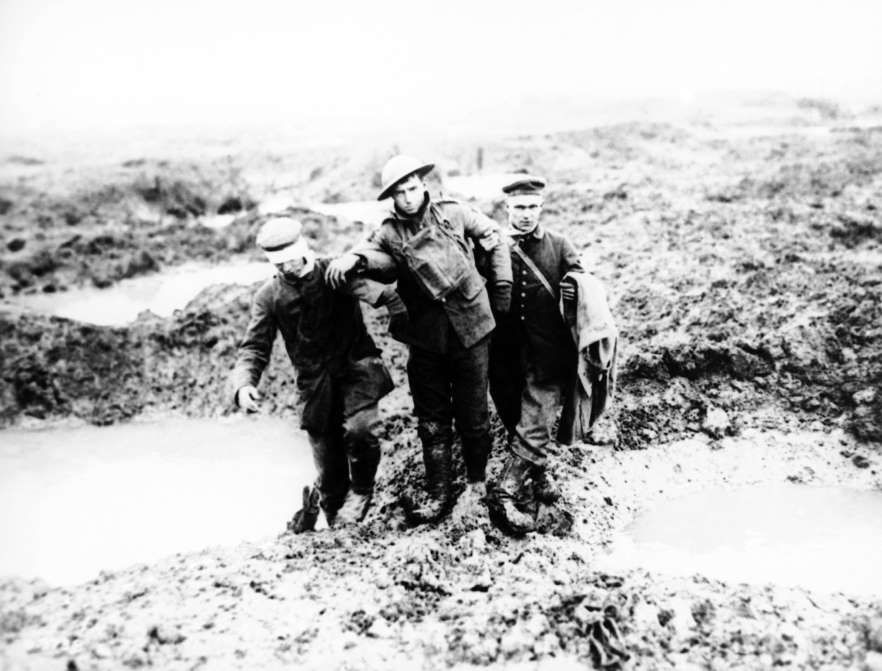 Today in history november 6 1917 wwi canadian victory in this 1917 file photo wounded canadian and german world war i soldiers help one another through the mud during the battle of passchendaele in sciox Gallery