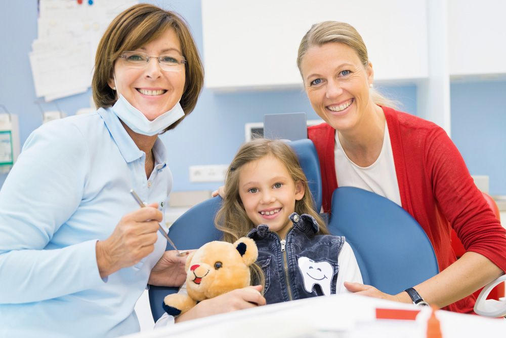 Our dentists with kid Kids dentist, Dental clinic, Dental