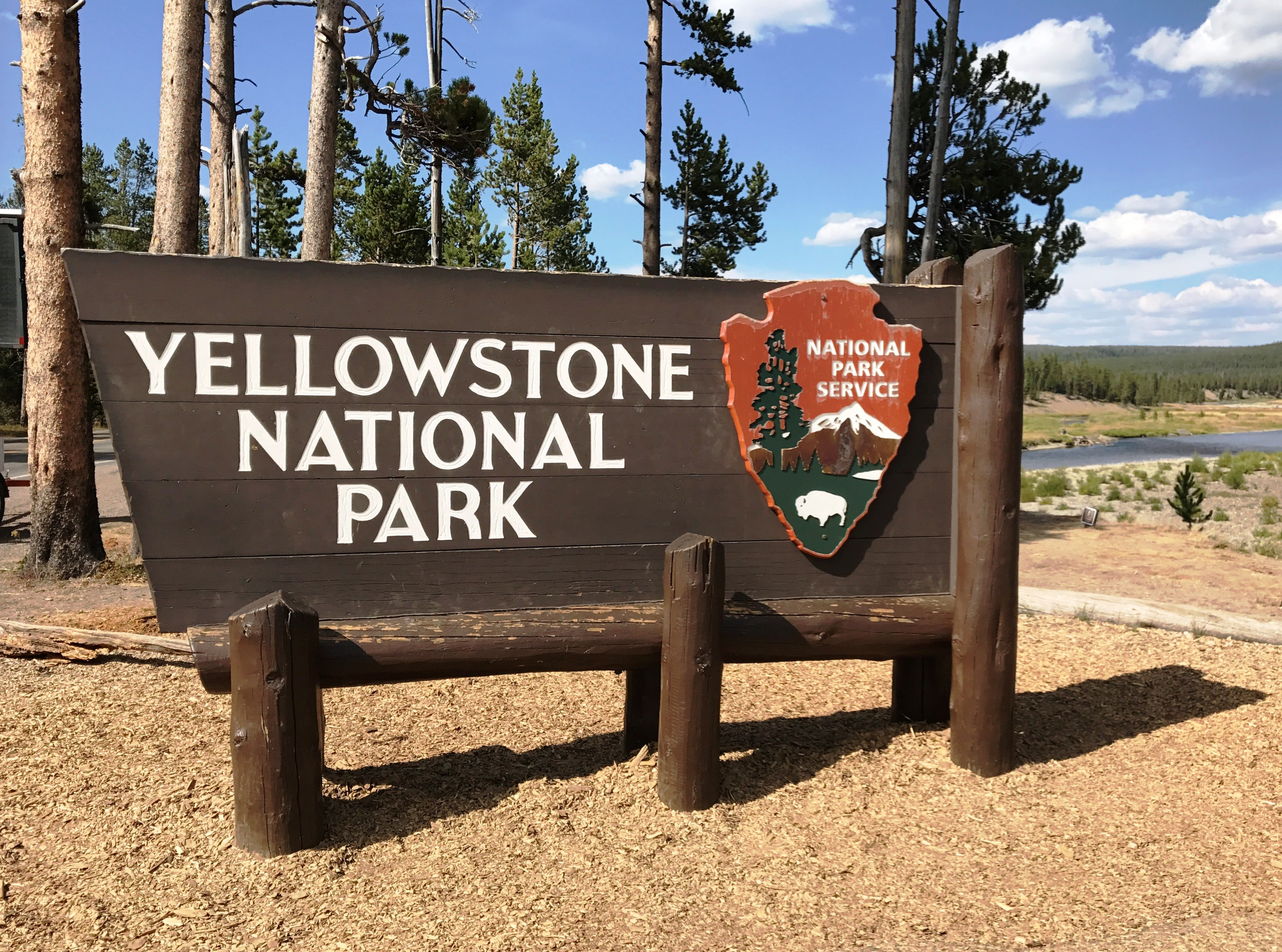 The iconic entrance sign to Yellowstone National Park. A very popular spot to take photos in fro… | National parks, National park signs, Most visited national parks