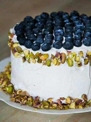 White cake with butter creme icing. Blue berries & pistachios. Yummy!!!