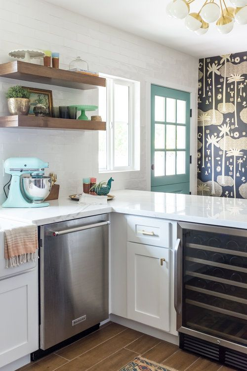 Funky palm tree wallpaper accent wall in kitchen with floating ...