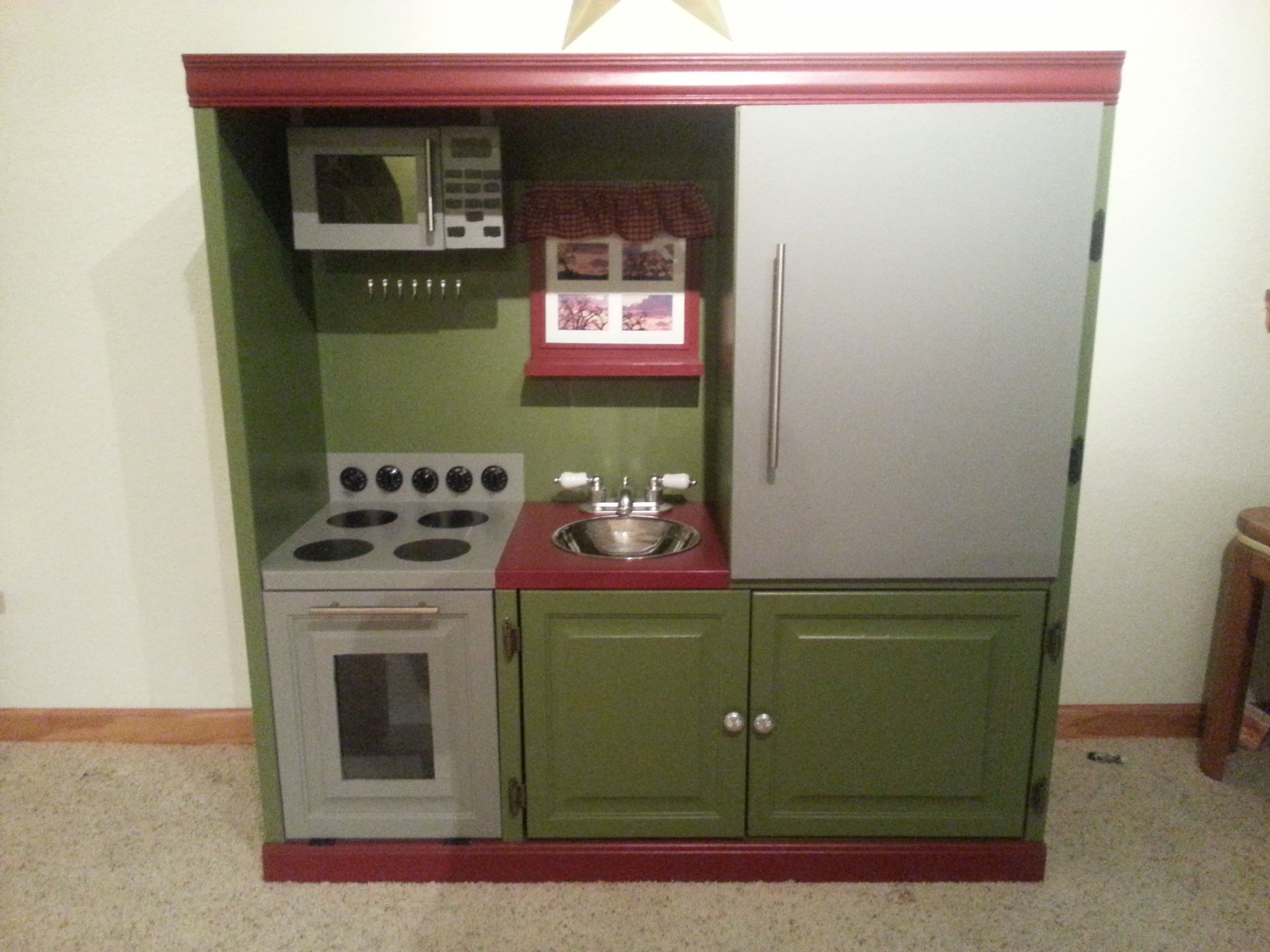 Old Entertainment Center Turned Into A Child Size Kitchen