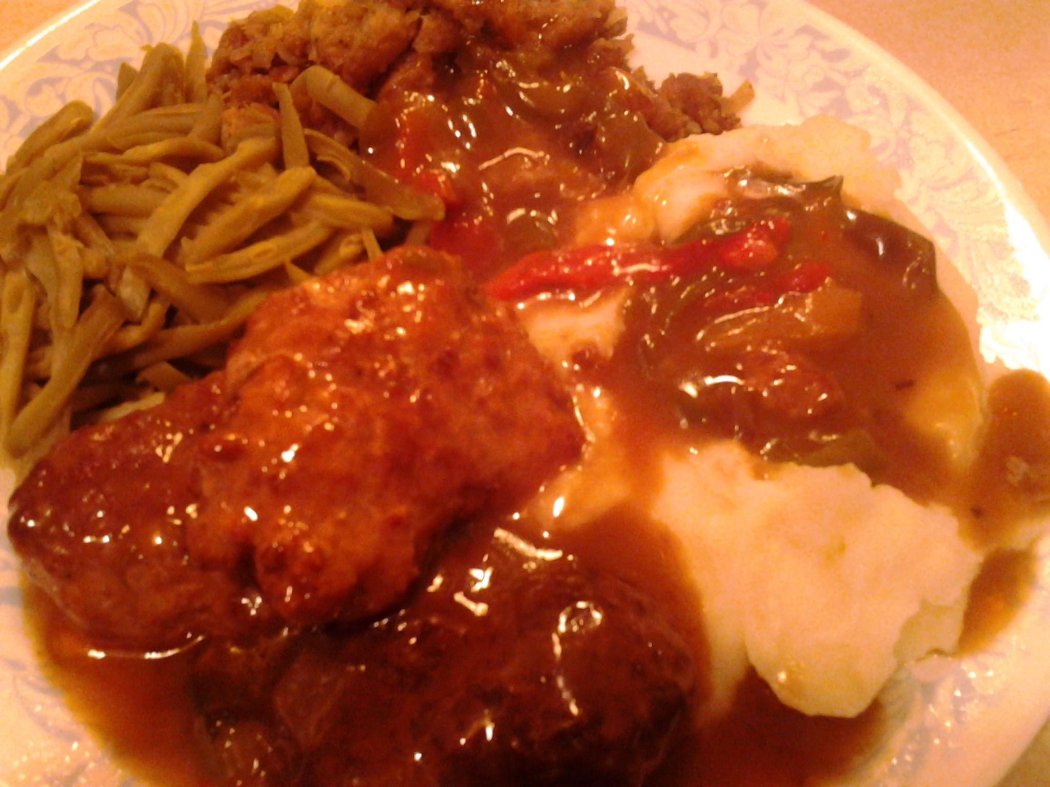 Crock pot Italian sausage patties, mashed taters, stuffing, green beans, all covered in a nice brown gravy.