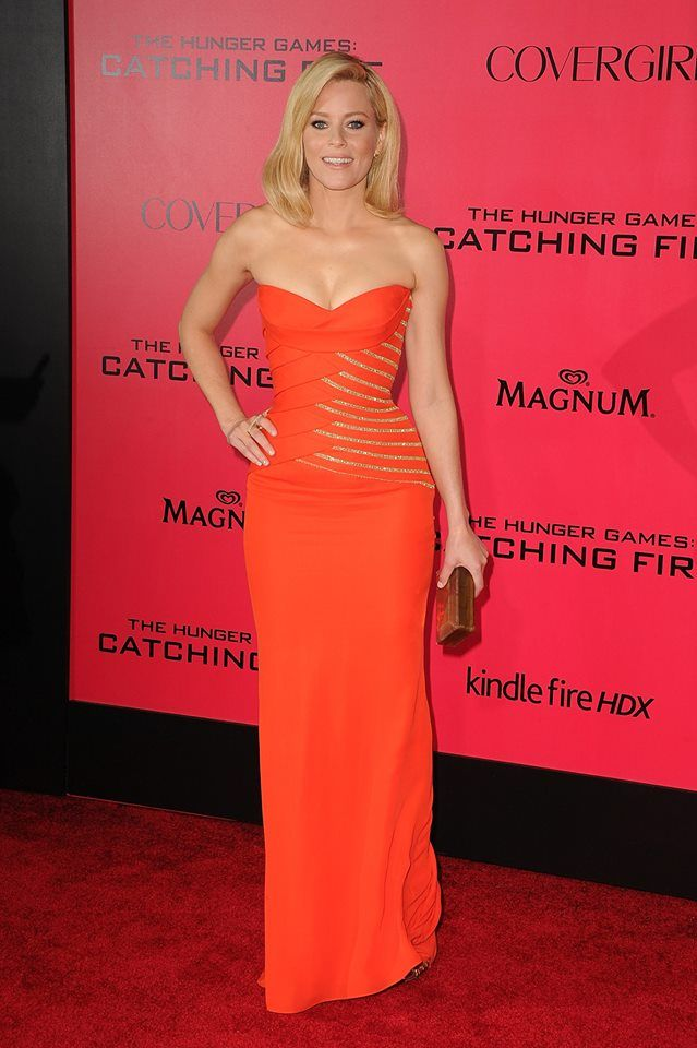 Elizabeth Banks was absolutely breathtaking in a stunning strapless orange Versace gown at the Los Angeles premiere for 'The Hunger Games: Catching Fire'. #VersaceCelebrities