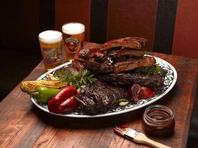 Guy Fieri's Root Beer BBQ Sauce (the sauce recipe is with his ribs recipe, but sounds good for BBQ chicken, pulled pork, etc.)