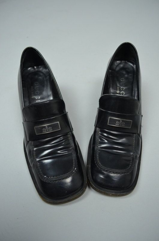 f06906437 Sweet 90s Gucci loafers! Chunky heels with a boxy mod shape! Done in a  glossy black leather. Leather soles. Slip on style. Vamps are decorated