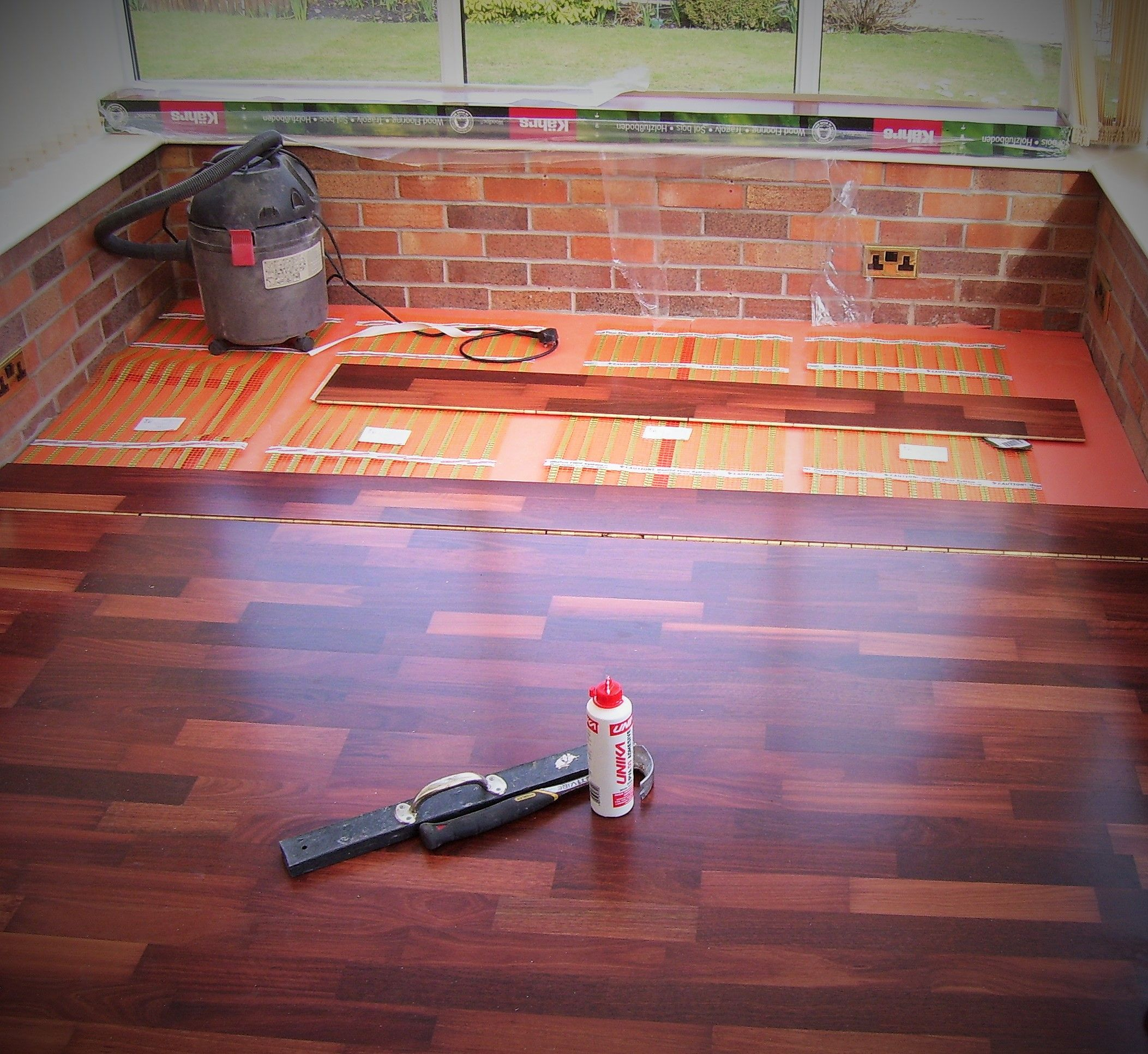 Allbrite S Electric Ribbon Underfloor Heating Being Installed In A Conservatory Under Laminate Radiant Floor Systems Diy Hardwood Floors