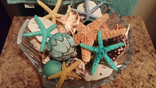 Painted & Dazzled these Star Fish for our remodeled bathroom from Christmas Tree Shop