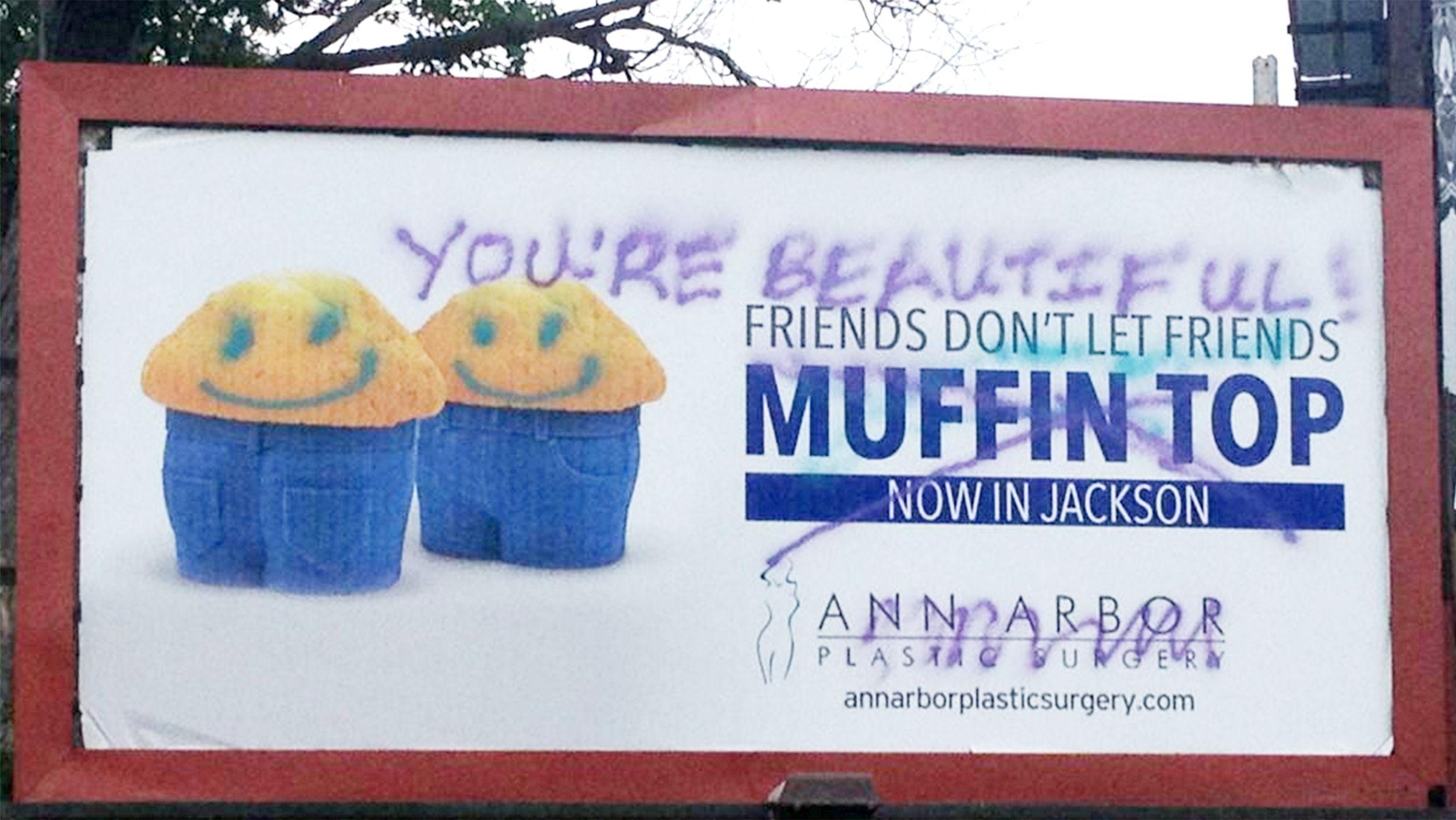 Plastic surgeon's 'muffin top' billboard gets a graffiti makeover
