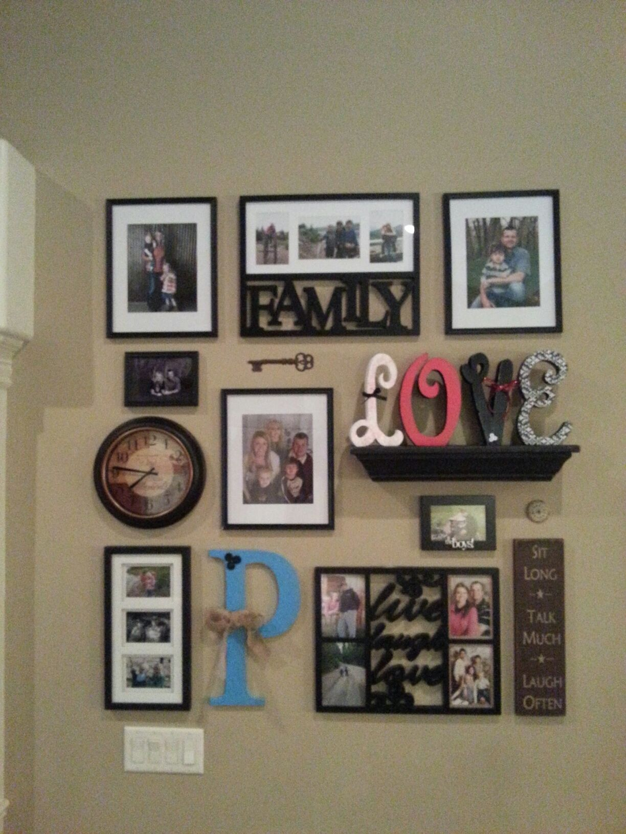 Collage wall great idea to add clock and self to hold