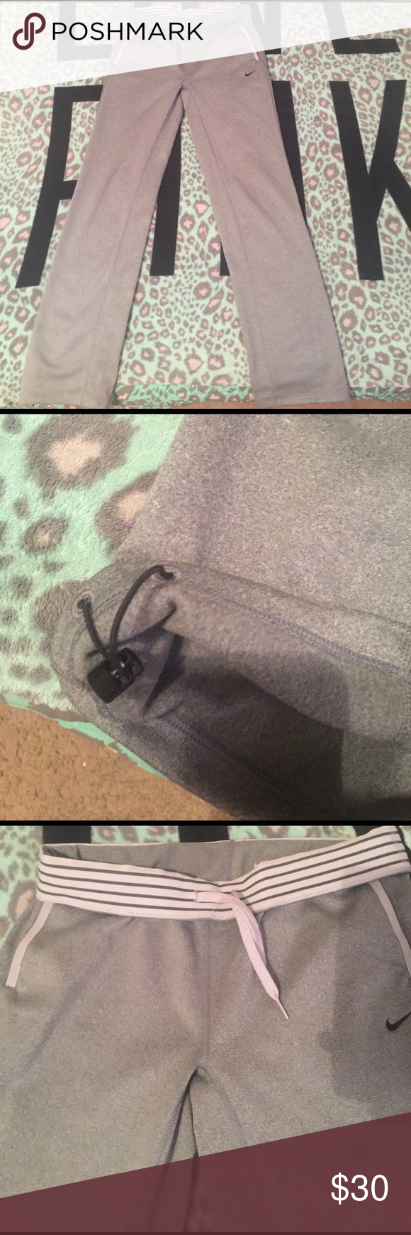 Nike dri-fit sweatpants Very cute, comfy sweats worn once so price is already dropped by 10 bucks of what I paid for them! One flaw is the very small look like marker spot on the bottom of pants shown in pic....ships asap Nike Other