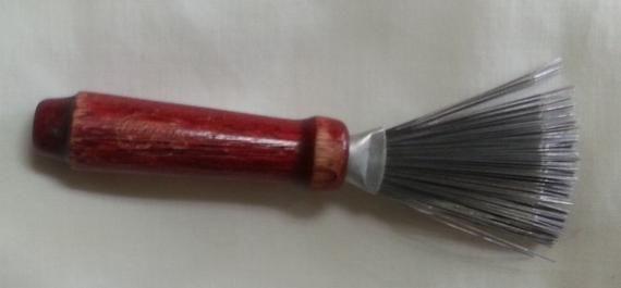 Photo of Bruch cleaner, early 1940's hair brush and shaving brush cleaner or rake