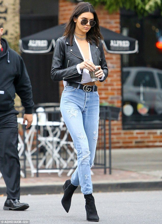 All about the accessories: The reality star added a black leather jacket, matching heeled ankle boots and a chunky belt, along with ripped skinny jeans and several choker necklaces